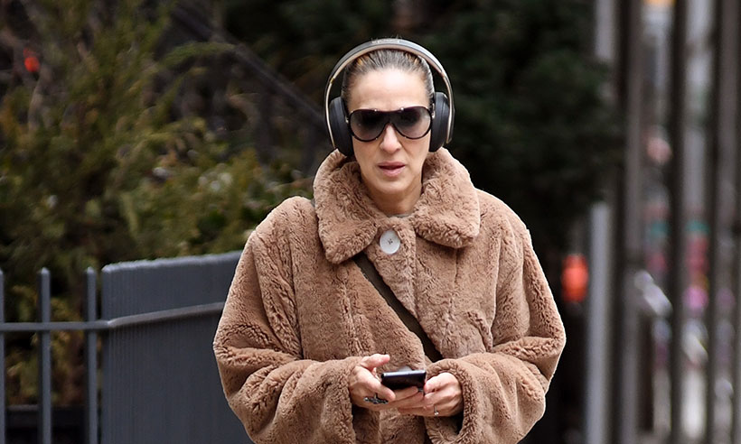 Sarah Jessica Parker wearing teddy coat and headphones
