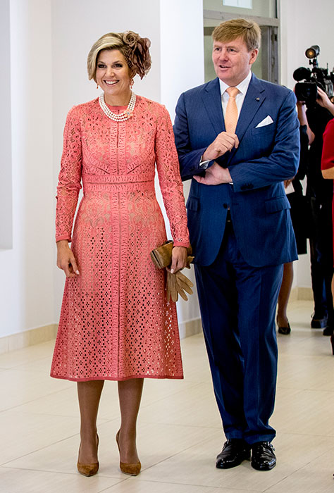 Queen Maxima wearing a coral dress