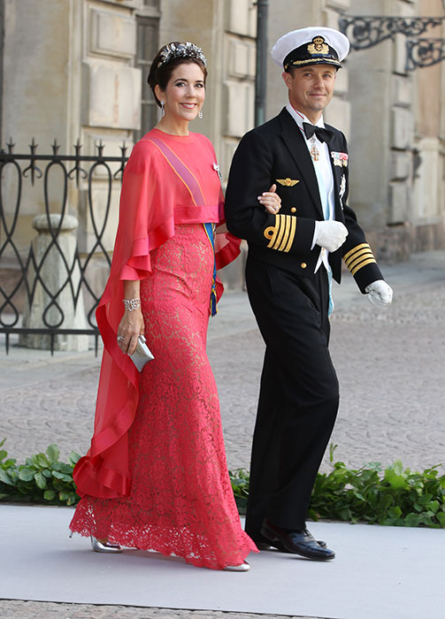 Crown Princess Mary wearing a coral dress