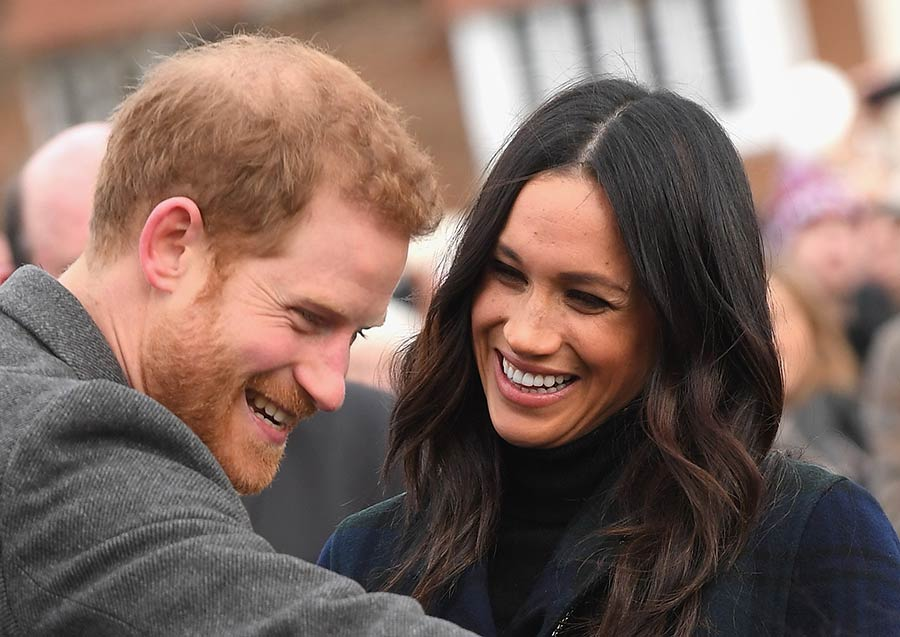 Meghan Markle laughing at Prince Harry